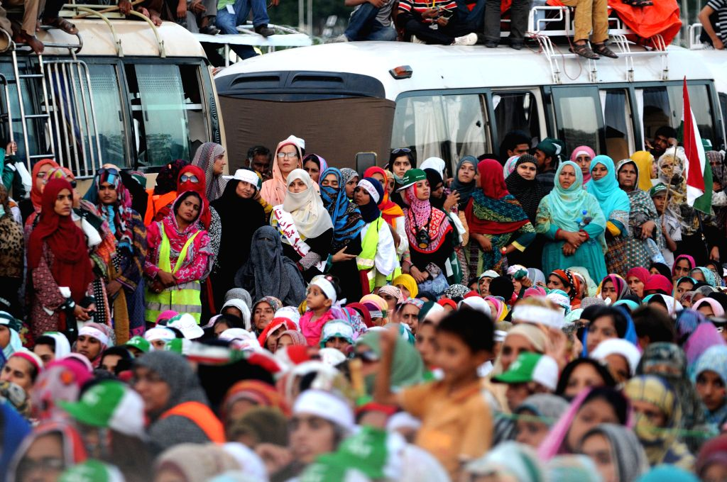 Supporters of religious leader Tahir-ul-Qadri gather during an anti-government protest in front of the parliament building in Islamabad, capital of Pakistan, on ..