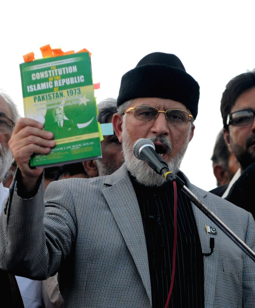 Religious leader Tahir-ul-Qadri speaks to his supporters during an anti-government protest in front of the parliament building in Islamabad, capital of Pakistan, . - Nawaz Sharif