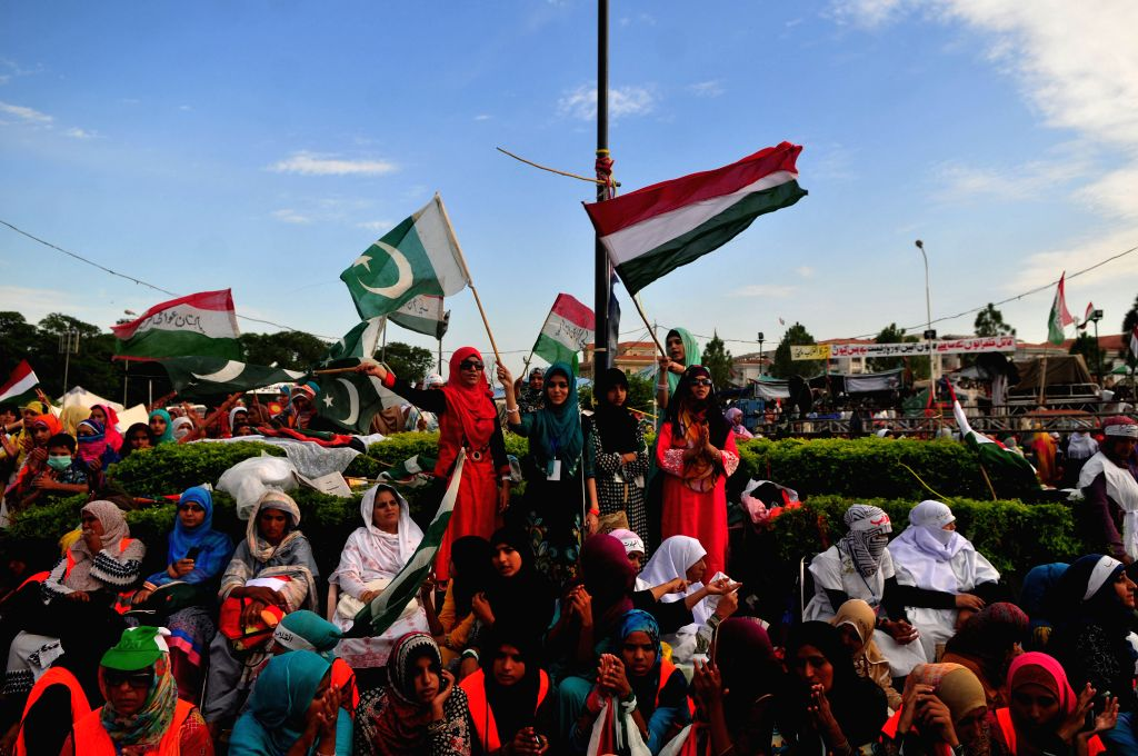 Supporters of religious leader Tahir-ul-Qadri gather during an anti-government protest in front of the parliament building in Islamabad, capital of Pakistan, on .. - Nawaz Sharif