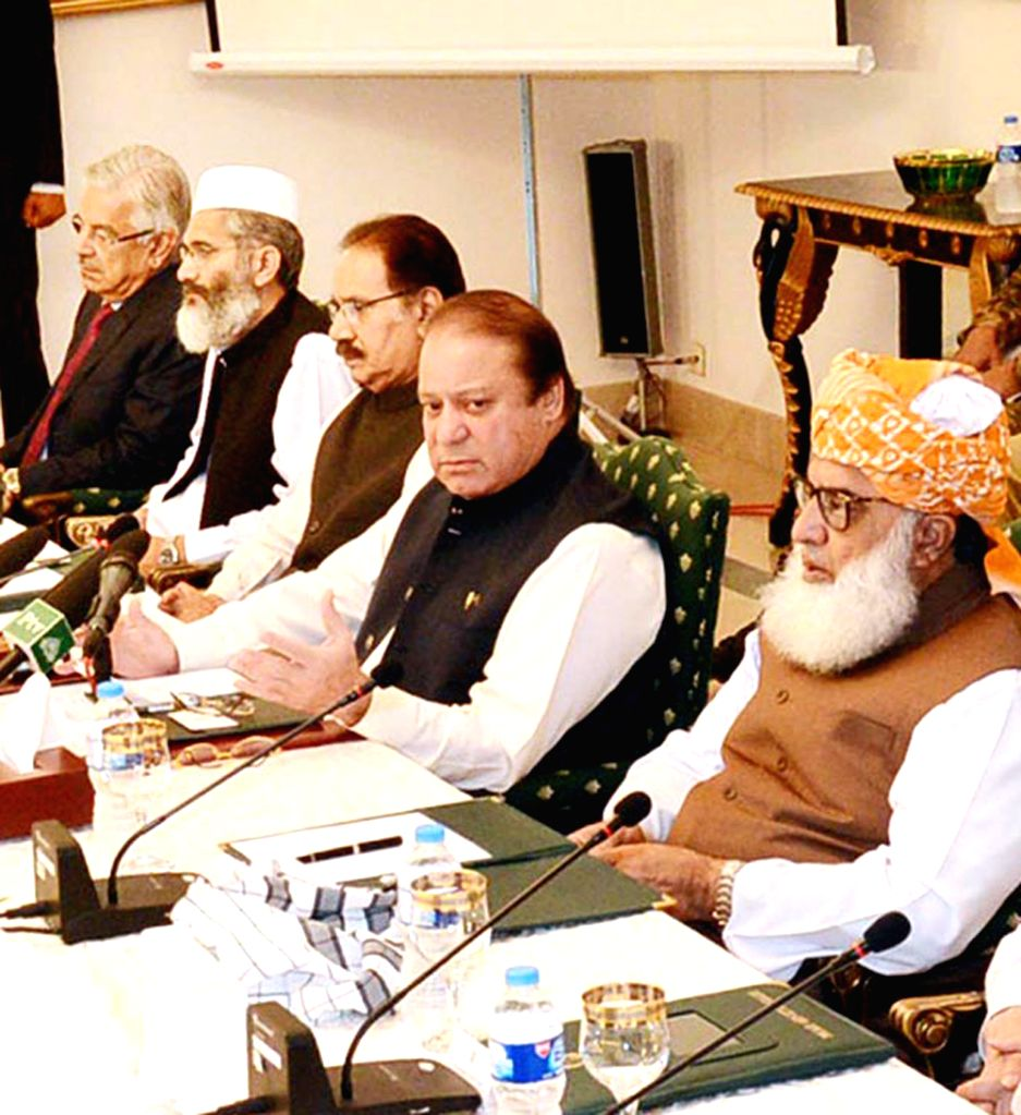 Photo released by Pakistan's Press Information Department (PID) on Aug. 9, 2014, shows Pakistani Prime Minister Nawaz Sharif (2nd R) addressing National Security ..