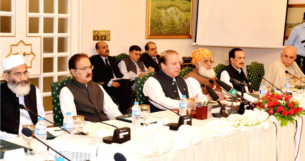 Photo released by Pakistan's Press Information Department (PID) on Aug. 9, 2014, shows Pakistani Prime Minister Nawaz Sharif (2nd L front) addressing National ...