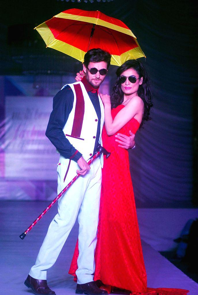 Models present creations by designer Aliya Khan during a fashion show in Islamabad, capital of Pakistan, on Dec. 14, 2014. - Aliya Khan