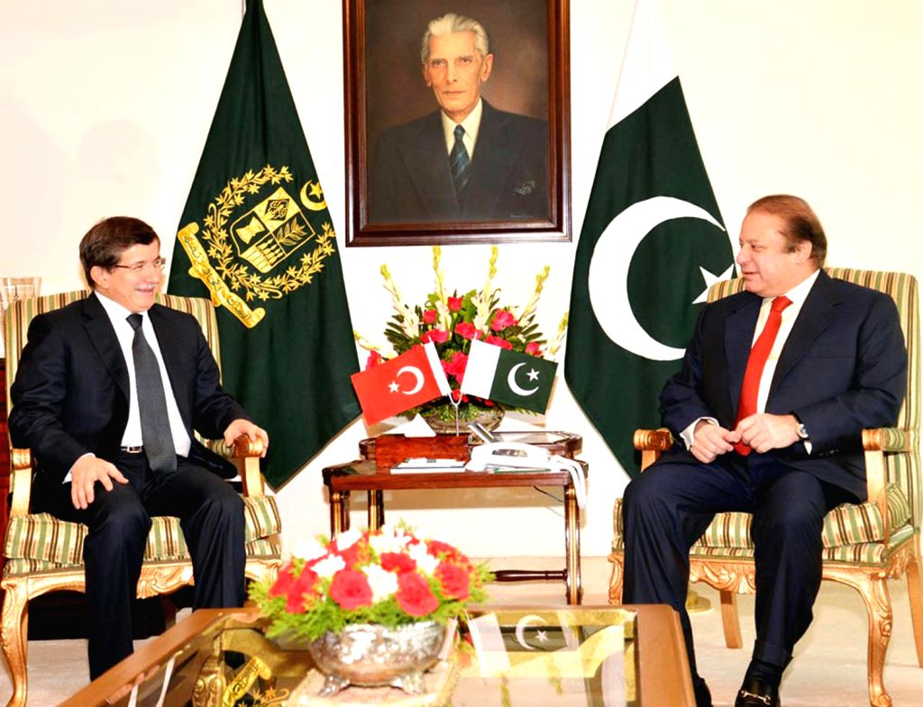 Photo released by Pakistan's Press Information Department (PID) on Dec. 19, 2013 shows Turkish Foreign Minister Ahmet Davutoglu (L) meeting with ...