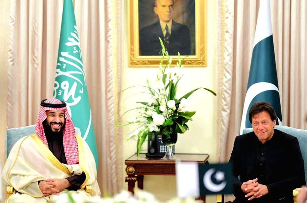 ISLAMABAD, Feb. 18, 2019 - Photo released by Pakistani Press Information Department (PID) on Feb. 18, 2019 shows Pakistani Prime Minister Imran Khan (R) meeting with Saudi Arabia's Crown Prince ... - Imran Khan