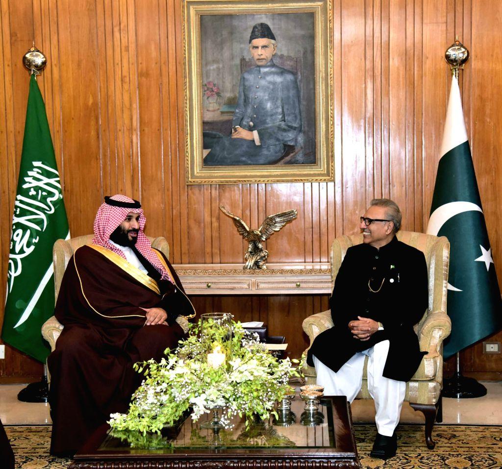 ISLAMABAD, Feb. 18, 2019 - Photo released by Pakistani Press Information Department (PID) shows Pakistani President Arif Alvi(R) meeting with Saudi Arabia's Crown Prince Mohammed bin Salman Al Saud ...