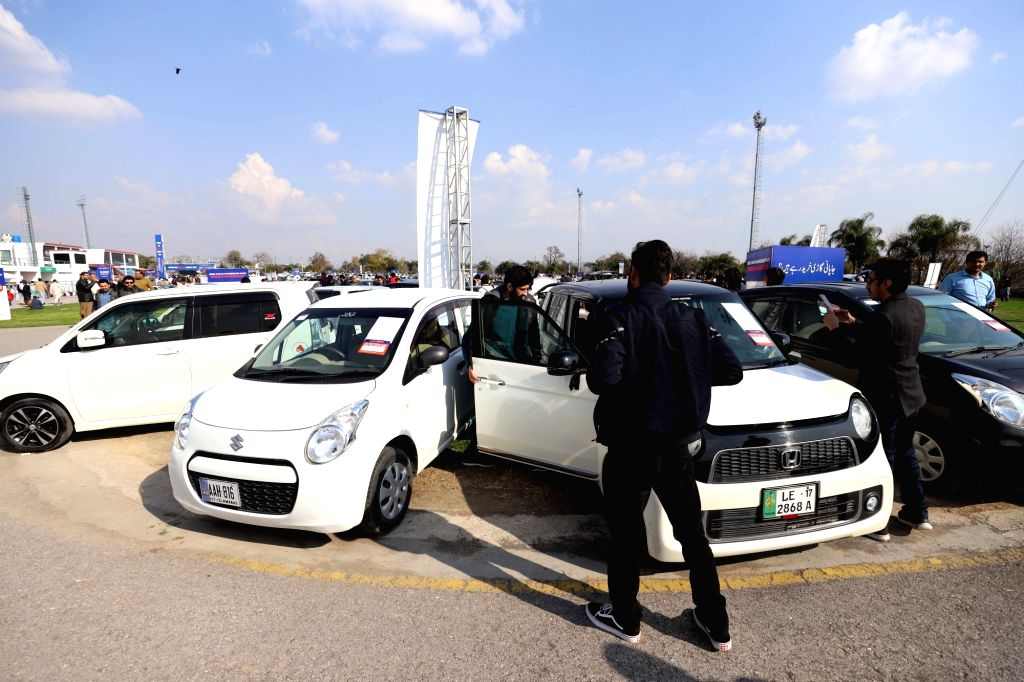 ISLAMABAD, Feb. 25, 2019 - People check a used car during used cars gala in Islamabad, capital of Pakistan on Feb. 24, 2019. The Used Car Gala 2019 was organized by PakWheels on Sunday in Islamabad, ...