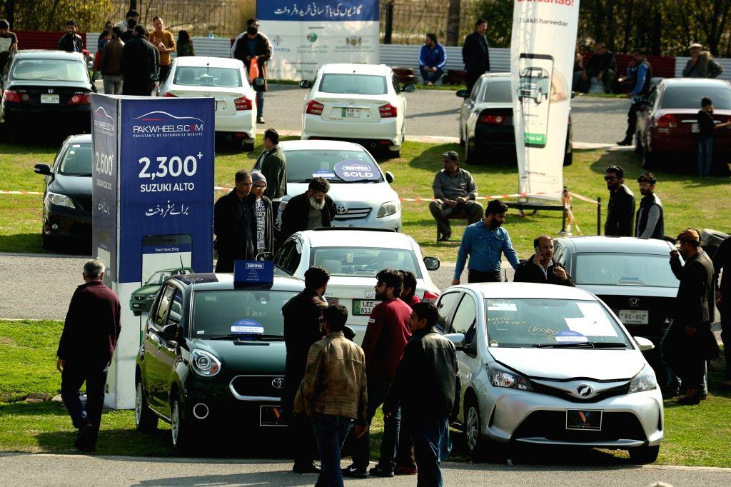 ISLAMABAD, Feb. 25, 2019 - People visit used cars gala in Islamabad, capital of Pakistan on Feb. 24, 2019. The Used Car Gala 2019 was organized by PakWheels on Sunday in Islamabad, displaying used ...