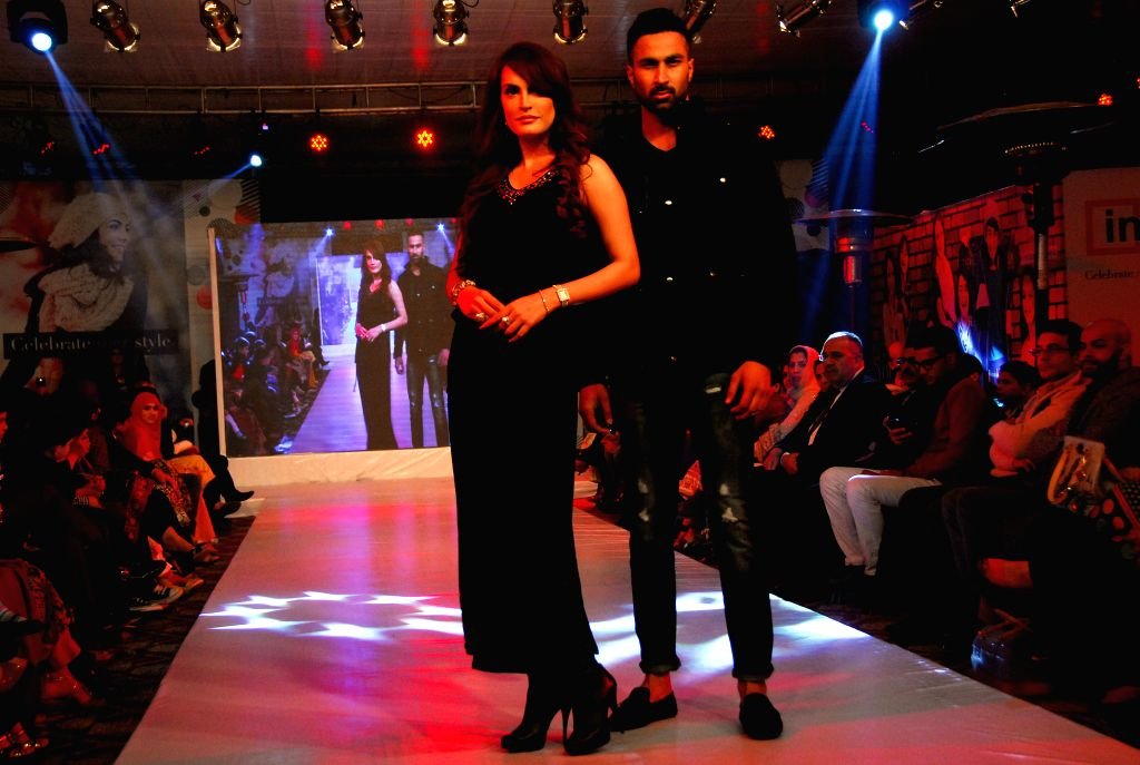 Models present creations by designer Fawaz Alhokair during a fashion show in Islamabad, capital of Pakistan on Jan. 11, 2015.