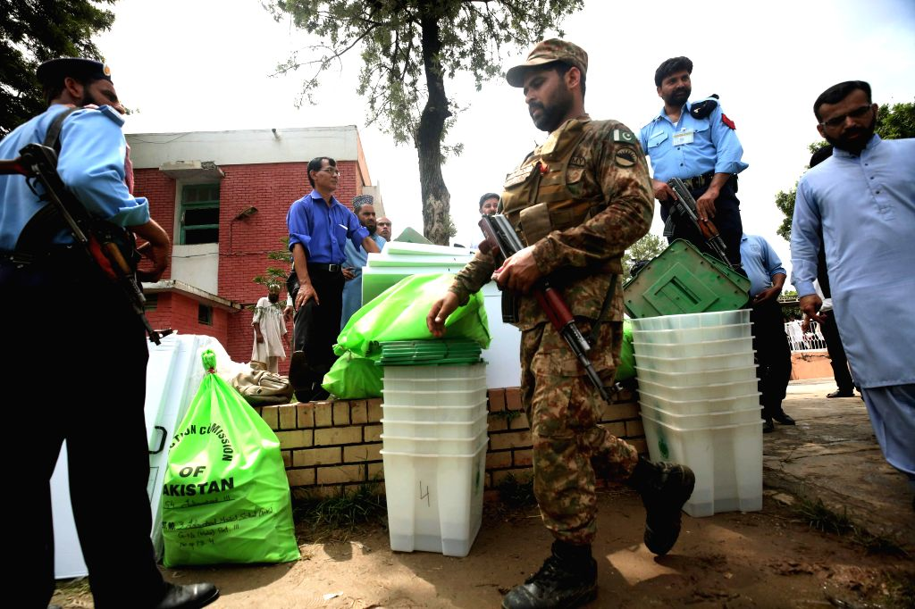 ISLAMABAD, July 24, 2018 - Security officials guard ballot boxes and voting materials at a distribution center in Islamabad, capital of Pakistan, on July 24, 2018. Pakistan will hold its general ...