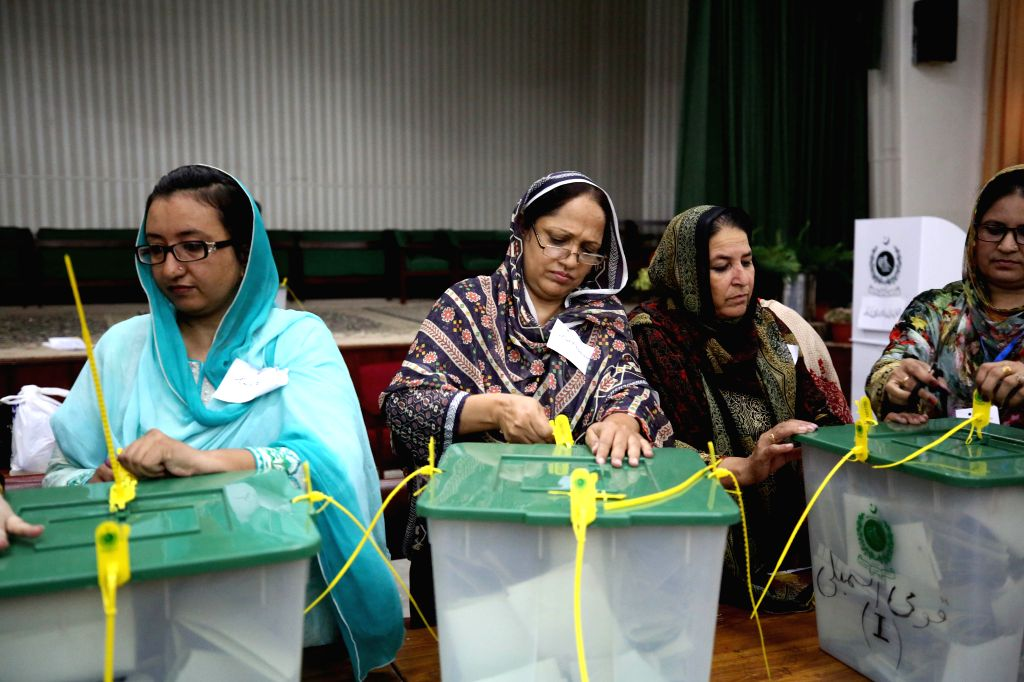 ISLAMABAD, July 25, 2018 - Election officials open ballot boxes to count votes in Islamabad, capital of Pakistan, on July 25, 2018. Pakistanis started casting votes in the country's one-day general ...
