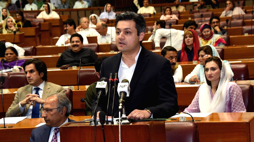 ISLAMABAD, June 11, 2019 (Xinhua) -- The photo released by Pakistan's Press Information Department (PID) on June 11, 2019 shows Pakistani Minister of Revenue Muhammad Hammad Azhar (front) presenting the federal budget for the fiscal year 2019-20 in I
