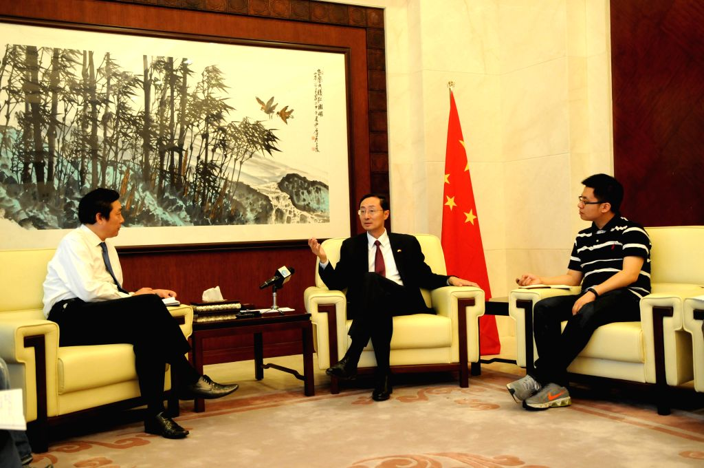 ISLAMABAD, June 24, 2016 - Chinese Ambassador to Pakistan Sun Weidong (C) is interviewed by reporters of Xinhua News Agency in Islamabad, June 23, 2016. The China-Pakistan Economic Corridor (CPEC) is ...