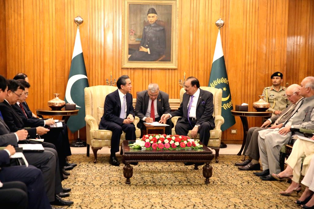ISLAMABAD, June 25, 2017 - Pakistani President Mamnoon Hussain (center R) meets with visiting Chinese Foreign Minister Wang Yi (center L) in Islamabad, Pakistan, on June 25, 2017. - Wang Y