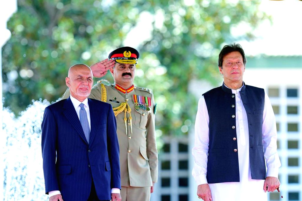 ISLAMABAD, June 27, 2019 (Xinhua) -- Photo released by Pakistan's Press Information Department (PID) on June 27, 2019 shows Pakistani Prime Minister Imran Khan (R, front) and visiting Afghan President Mohammad Ashraf Ghani  (L, front) inspecting the  - Imran Khan