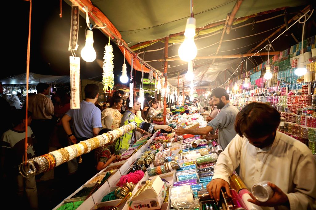 ISLAMABAD, June 5, 2019 - People shop on the eve of Eid al-Fitr holiday, which marks the end of holy month of Ramadan, in Islamabad, capital of Pakistan, June 4, 2019.
