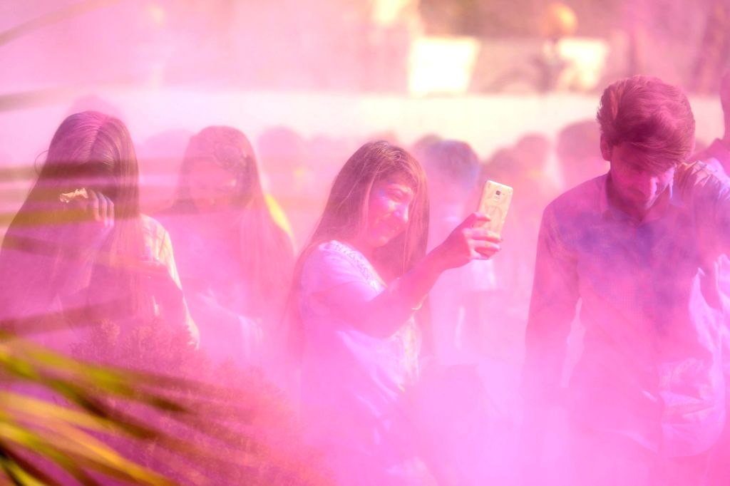 ISLAMABAD, March 10, 2019 - A girl takes a selfie during a color fight to celebrate spring in Islamabad, capital of Pakistan, on March 9, 2019.