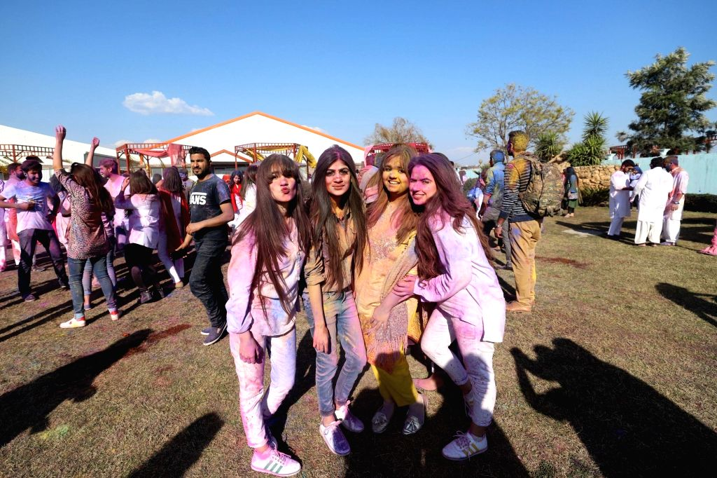 ISLAMABAD, March 10, 2019 - Girls with colored faces pose for a photo during a color fight to celebrate spring in Islamabad, capital of Pakistan, on March 9, 2019.
