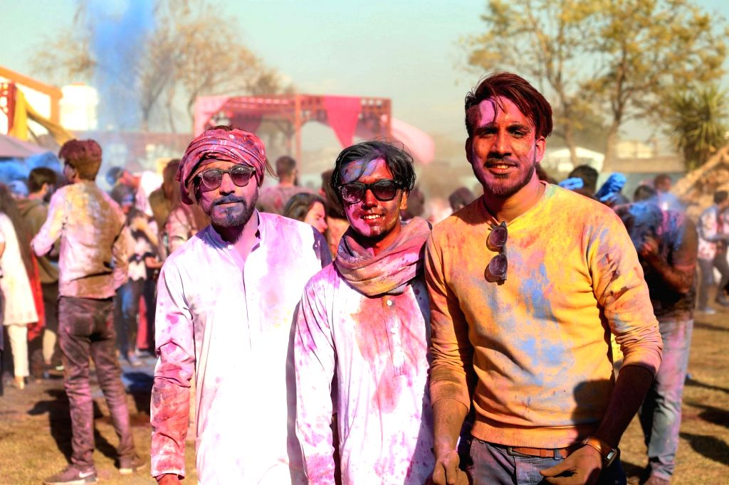 ISLAMABAD, March 10, 2019 - People with colored faces pose for a photo during a color fight to celebrate spring in Islamabad, capital of Pakistan, on March 9, 2019.