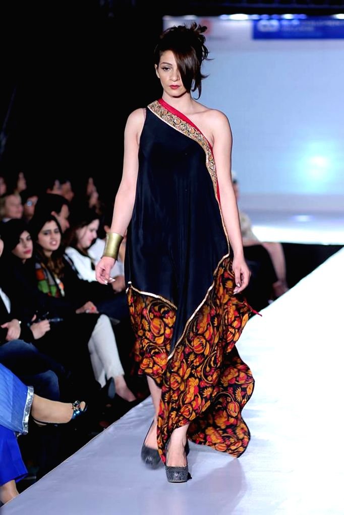 A model presents a creation by designer Nargis during a fashion show in Islamabad, capital of Pakistan, March 29, 2015.