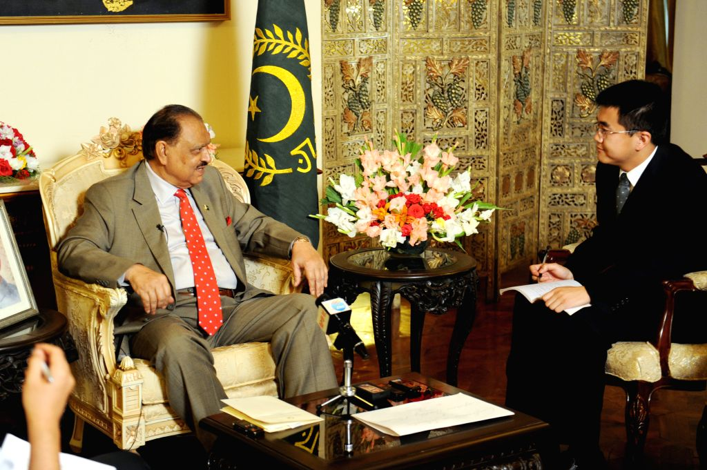 Pakistani President Mamnoon Hussain (L) speaks during an interview with Chinese media in Islamabad, Pakistan, May 16, 2014. Pakistani President Mamnoon Hussain ...