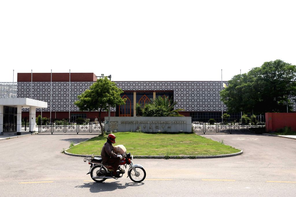 ISLAMABAD, May 25, 2019 - A motorcyclist drives past the building of Pakistan-China Friendship center in Islamabad, capital of Pakistan, on May 22, 2019. China and Pakistan will join hands in ...