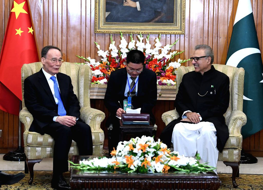 ISLAMABAD, May 28, 2019 - Chinese Vice President Wang Qishan (L) meets with Pakistani President Arif Alvi in Islamabad, Pakistan, May 26, 2019. Wang Qishan visited Pakistan from Sunday to Tuesday and ... - Imran Khan