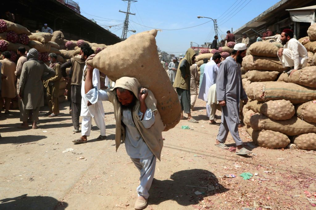 ISLAMABAD, May 6, 2019 - A man carries a sack of vegetable at a fruit and vegetable market ahead of the Ramadan in Islamabad, capital of Pakistan on May 6, 2019.
