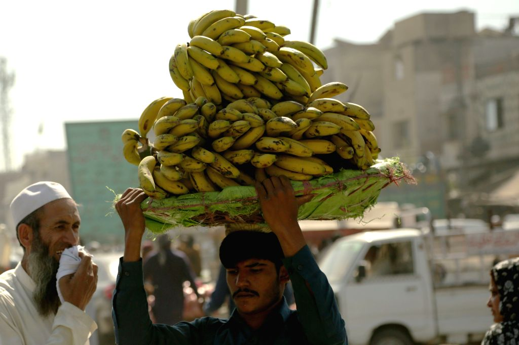ISLAMABAD, May 6, 2019 - A man carries bananas at a fruit and vegetable market ahead of the Ramadan in Islamabad, capital of Pakistan on May 6, 2019.