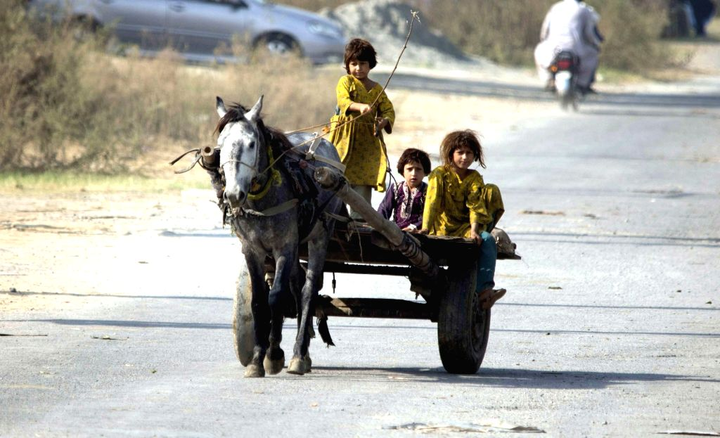 ISLAMABAD, Nov. 20, 2017 (Xinhua) -- Pakistani girls ride on a horse-cart at a street on Universal Children's Day in Islamabad, capital of Pakistan on Nov. 20, 2017. United Nations Universal Children's Day was established in 1954 and is celebrated on
