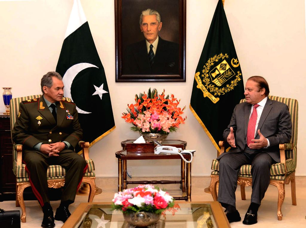 Islamabad (Pakistan): Photo released by the Press Information Department (PID) on Nov. 20, 2014, shows Pakistani Prime Minister Nawaz Sharif (R) meeting with Russian Defense Minister Sergei Shoigu at