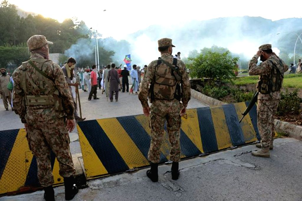 Pakistani paramilitary troops stand guard during a clash in Islamabad, capital of Pakistan on Sept. 1, 2014. At least 15 more people were injured on Monday ...