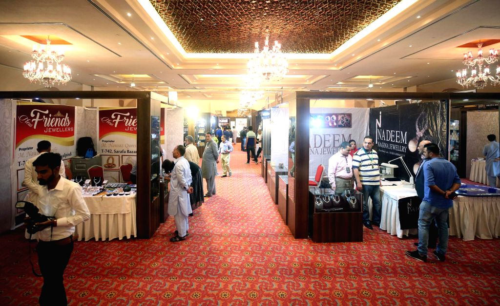 ISLAMABAD, Sept. 15, 2018 - People visit stall during the gems and jewellery exhibition in Islamabad, capital of Pakistan, on Sept. 14, 2018. The three-day gems and jewellery exhibition kicked off in ...
