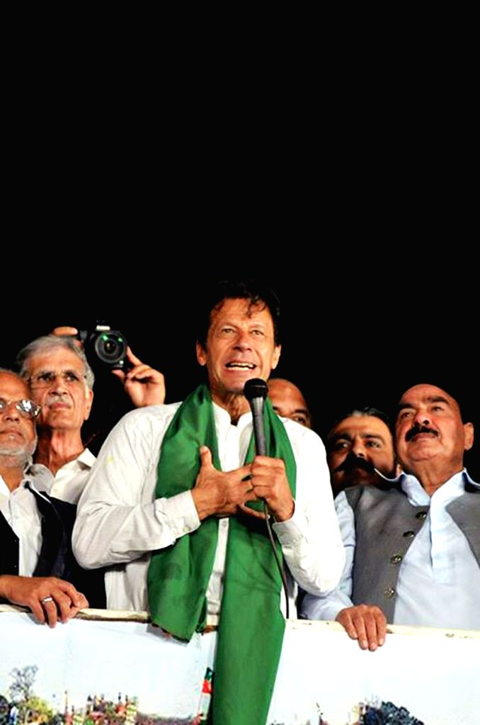 Leader of Pakistan Tehrik-e-Insaf party Imran Khan (C) addresses supporters during an anti-government protest near the prime minister's residence in Islamabad, ... - Nawaz Sharif and Imran Khan