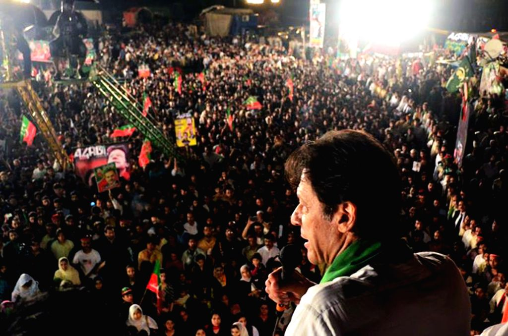 Leader of Pakistan Tehrik-e-Insaf party Imran Khan (R) addresses supporters during an anti-government protest near the prime minister's residence in Islamabad, ... - Nawaz Sharif and Imran Khan
