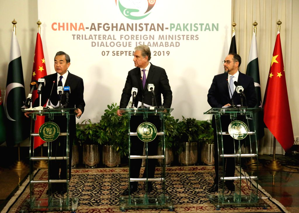 ISLAMABAD, Sept. 8, 2019 (Xinhua) -- Chinese State Councilor and Foreign Minister Wang Yi (L), Pakistani Foreign Minister Shah Mahmood Qureshi (C) and Afghan Foreign Minister Salahuddin Rabbani meet the press after the 3rd China-Afghanistan-Pakistan  - Wang Y and Mahmood Qureshi