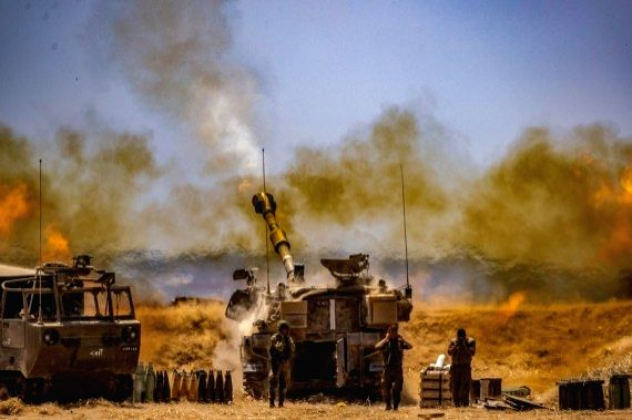 Israeli army Artillery Corps fire into the Gaza Strip near the southern Israeli city of Sderot amid escalating tension on May 12, 2021.