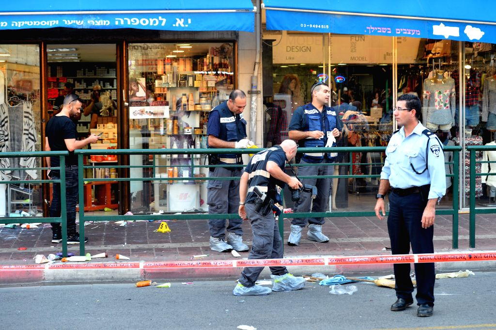 Israeli police forensic experts inspect the scene of a stabbing in Rishon Letzion, a major city south of Tel Aviv, Israel, on Nov. 2, 2015. A knife-wielding ...