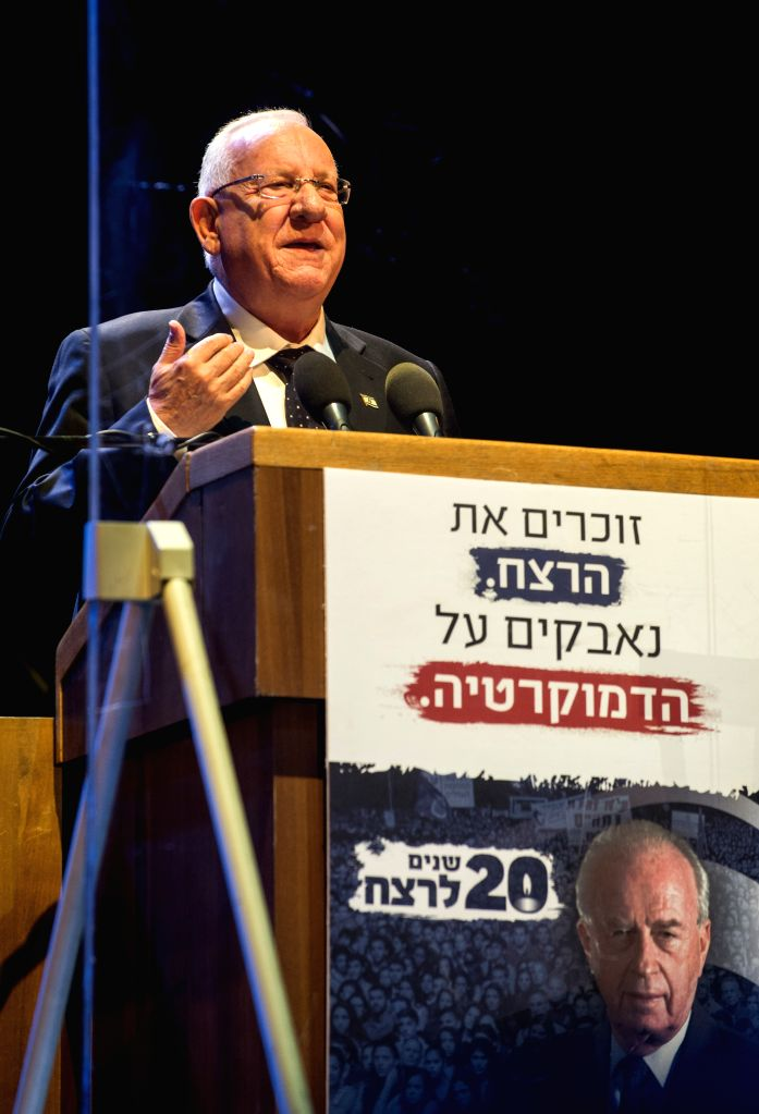 Israeli President Reuven Rivlin delivers a speech in a rally at the Tel Aviv square marking the anniversary of Rabin's assassination, Oct. 31, 2015. About 100,000 ... - Yitzhak Rabin