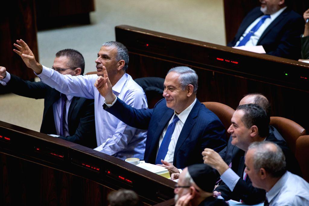 Israeli Prime Minister Benjamin Netanyahu (3rd L, Front) and Israeli Finance Minister Moshe Kahlon (2nd L, Front) gesture during the state budget vote for ... - Benjamin Netanyahu