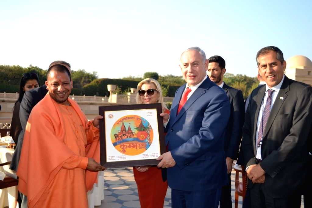 Israeli Prime Minister Benjamin Netanyahu and his wife Sara with Uttar Pradesh Chief Minister Yogi Adityanath during their visit to the Taj Mahal on his arrival in Agra on Jan 16, 2018. - Benjamin Netanyahu