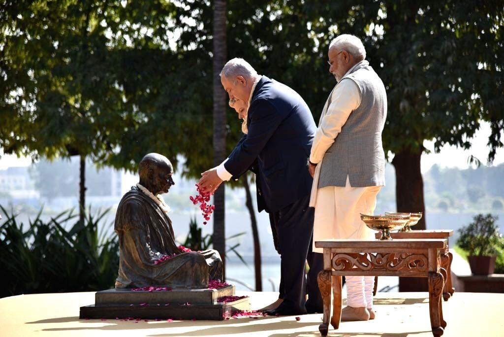 Israeli Prime Minister Benjamin Netanyahu and his wife Sara Netanyahu pay homage to Mahatma Gandhi in the presence of Prime Minister Narendra Modi during their visit to Sabarmati Ashram in ... - Benjamin Netanyahu and Narendra Modi