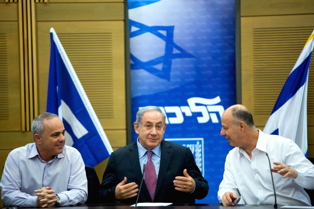Israeli Prime Minister Benjamin Netanyahu (C), Minister of Energy Yuval Steinitz (L) and Likud MK Tzachi Hanegbi attend a Likud faction meeting at Israeli Knesset ... - Benjamin Netanyahu