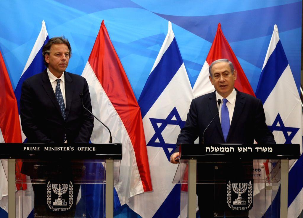 Israeli Prime Minister Benjamin Netanyahu (R) addresses a joint news conference with visiting Dutch Foreign Minister Bert Koenders in Jerusalem, on July 14, 2015. ... - Benjamin Netanyahu
