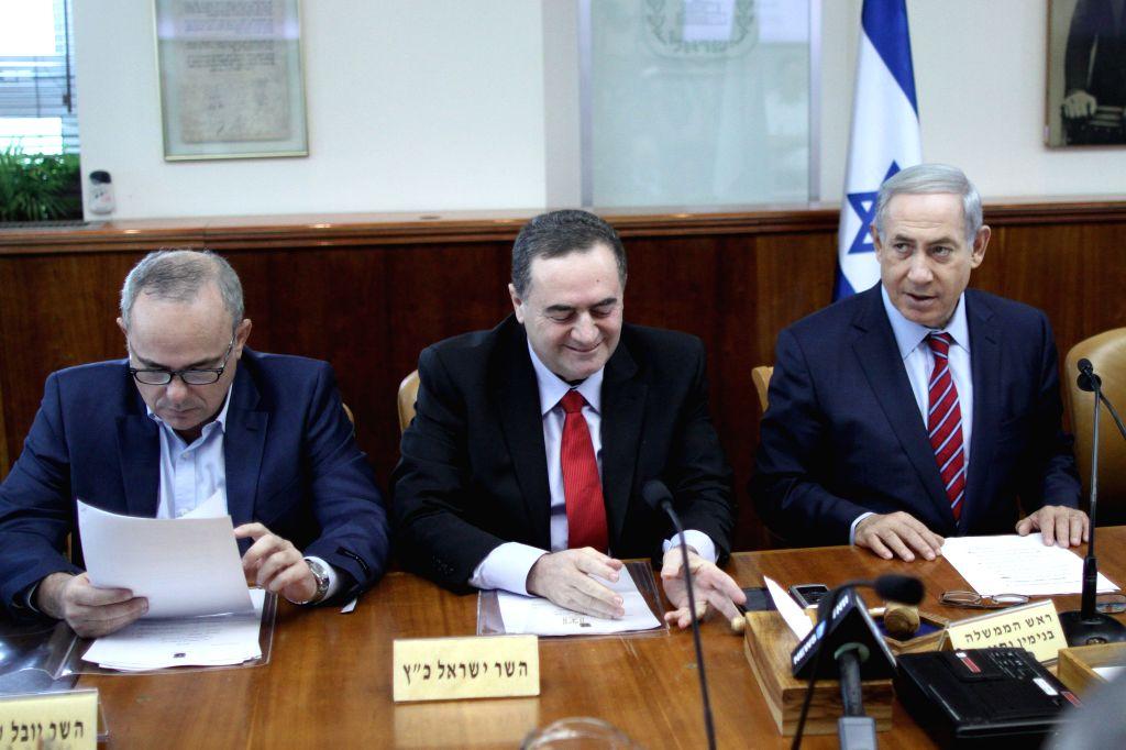 Israeli Prime Minister Benjamin Netanyahu (R) attends the weekly cabinet meeting at his office in Jerusalem, on Oct. 25, 2015. Israeli Prime Minister Benjamin ... - Benjamin Netanyahu