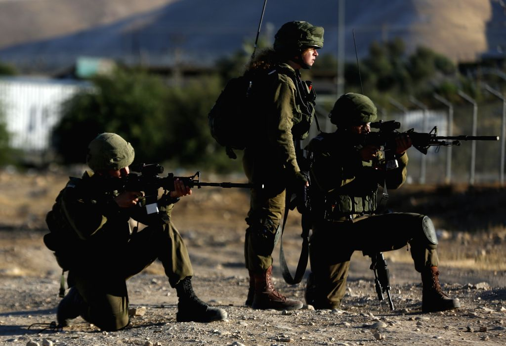Israeli soldiers aim their weapons at Palestinian protesters during clashes in Fasayil village in Jordan Valley, on June 24, 2020. Palestinian Prime Minister ... - Mohammed Ishtaye