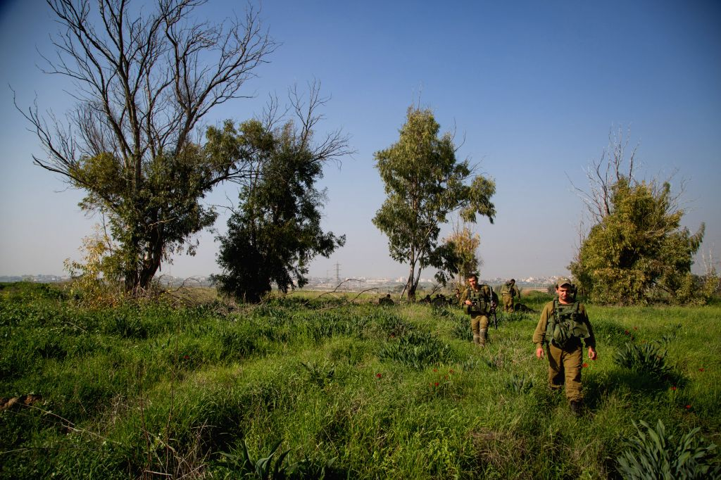 Israeli soldiers attend a military activity in southern Israel, Jan. 13, 2016. A Palestinian killed and three others injured in an Israeli air strike of the ...
