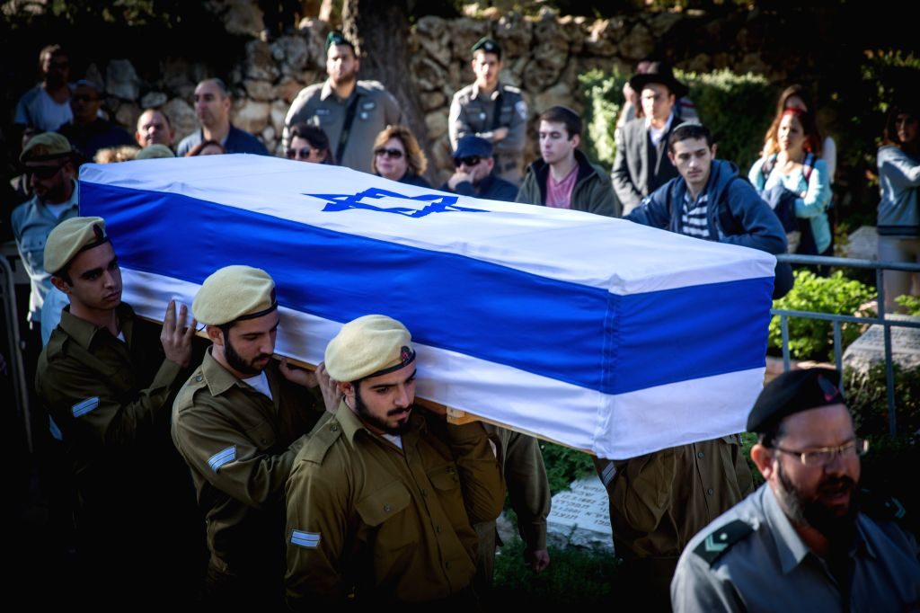 Israeli soldiers carry the coffin of 18-year-old soldier Ziv Mizrachi during his funeral ceremony at Mount Herzl Military Cemetery in Jerusalem, on Nov. 24, 2015. ...