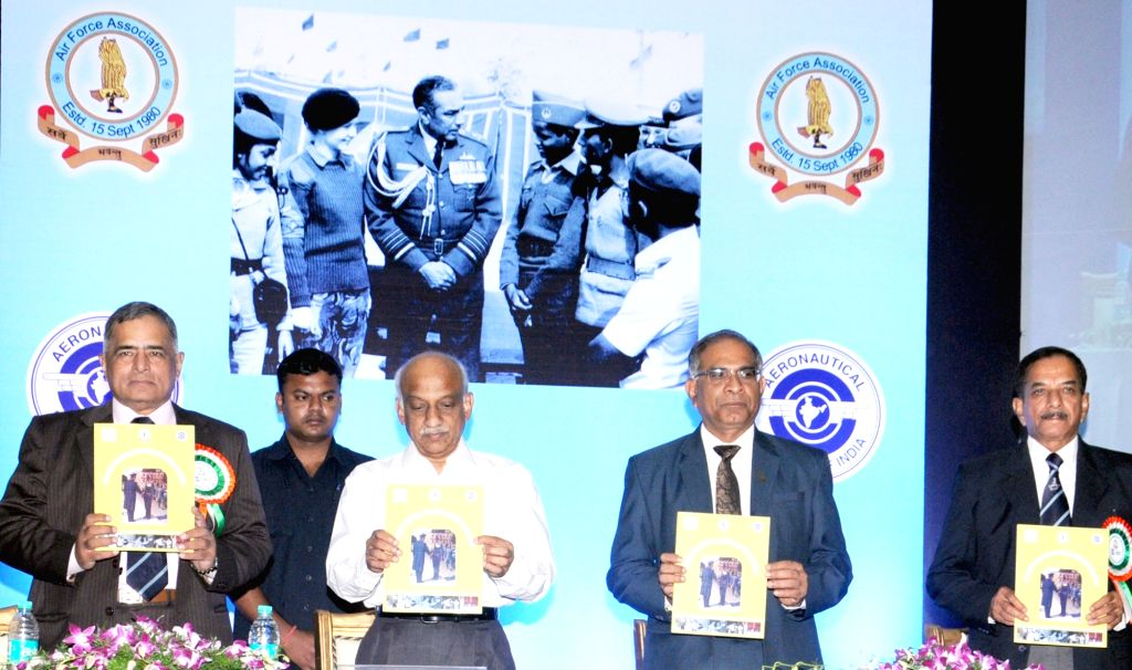 ISRO Chairman and Chairman Space Commission AS Kiran Kumar releases souvenir during the 9th Annual AIR Chief Marshal LM Katre memorial lecture in Bengaluru on April 23, 2016. - Kiran Kumar