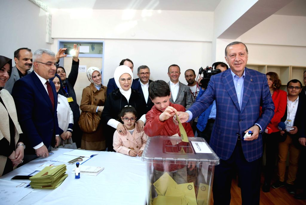 ISTANBUL, April 16, 2017 - Turkish President Recep Tayyip Erdogan (R, front) casts his ballot at a polling station in Istanbul, Turkey, on April 16, 2017. More than 167,000 polling stations across ...