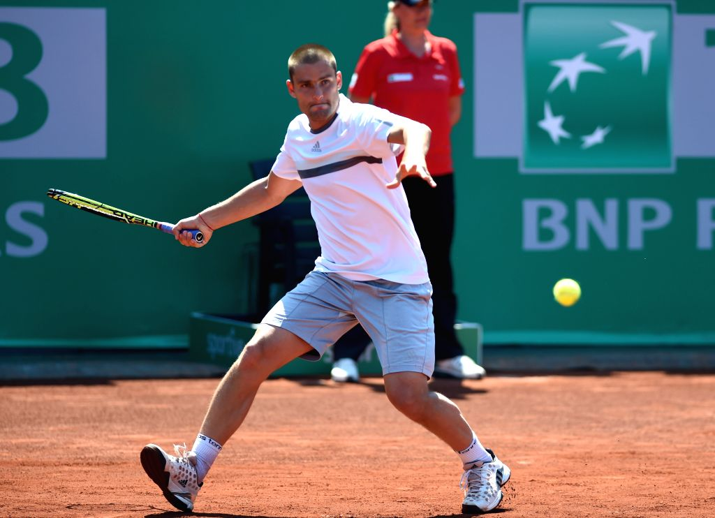 Russia's Mikhail Youzhny returns the ball during his first round match against Thomaz Bellucci of Brazil at ATP World Tour Istanbul Open in Istanbul, Turkey, on ...
